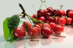 Cherries on glass plate Stock Photos