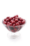 Cherries in a glass vase. Cherry compote in a glass vase on white background Stock Image