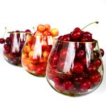 Cherries in glasses. Sweet red and white cherries in glasses Stock Photo