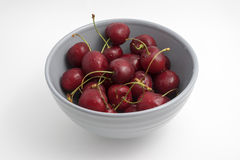 Cherries. In a gray bowl on a white background Stock Images
