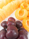 Cherries half apricots and yellow melon bites Stock Images