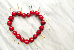 Cherries Heart. On marble background Royalty Free Stock Photo