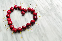 Cherries heart. On marble background Stock Photo