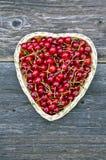 Cherries in heart shaped wicker basket Royalty Free Stock Photo