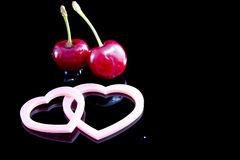 Cherries and hearts Stock Image