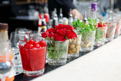 Cherries, herbs and flowers on bar counter Royalty Free Stock Photo