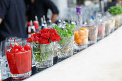 Cherries, herbs and flowers on bar counter Royalty Free Stock Photos