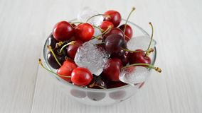 Cherries and ice cube Royalty Free Stock Photography