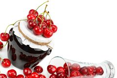 Cherries and jars of jam isolated on white background. Free spac Stock Photo