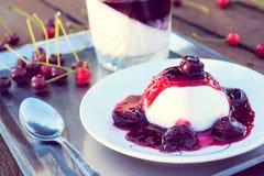 Cherries jelly on panna cotta Royalty Free Stock Image