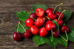 Cherries. Juice summer fruits with leaves royalty free stock photography