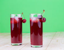 Cherries and juice Stock Photos