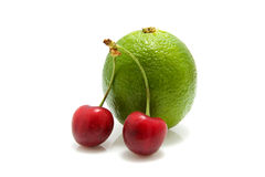 Cherries and lime Stock Image