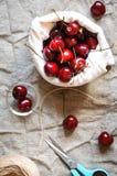 Cherries in linen bag, flat lay Stock Images