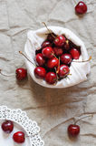 Cherries in linen bag, flat lay Royalty Free Stock Photos