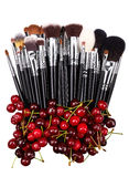 Cherries. Makeup brushes set. Isolated. White background Stock Images
