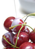 Cherries with milk IV. Pouring milk over cherries Royalty Free Stock Images