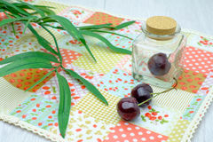 Cherries on napery Stock Image