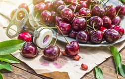 Cherries and old stone remover closeup Royalty Free Stock Image