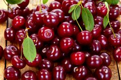 Cherries On Wooden Table Stock Images