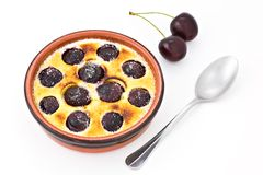 Cherries pancake. Cherry pancake and a spoon, isolated Stock Photos