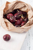 Cherries in a paper bag Stock Image