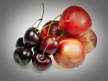 Cherries and peaches Royalty Free Stock Photos