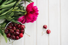 Cherries and peony Stock Image