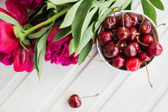Cherries and peony Royalty Free Stock Image