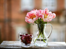 Cherries and Peony Flower Stock Images