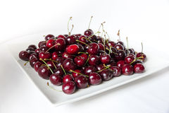 Cherries. Picture a plate of cherries on white background Stock Photos