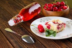 Cherries with pie plus lemonade in glass bottle Royalty Free Stock Photos