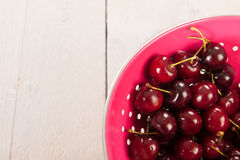 Cherries in pink colander Royalty Free Stock Photo