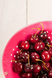 Cherries in pink colander Stock Photography