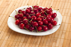 Cherries on plate Royalty Free Stock Images