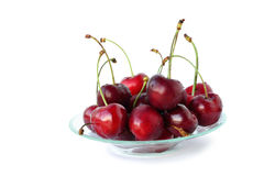 Cherries on plate isolated Royalty Free Stock Photo