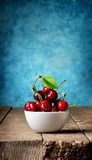 Cherries in plate Stock Image