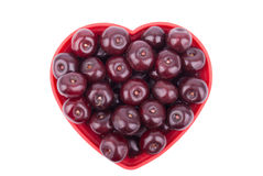 Cherries on a plate in the shape of a heart Stock Photography