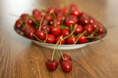 Cherries. A plate of cherries on the wooden table, healthy snack stock photography