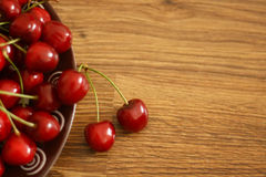 Cherries. A plate of cherries on the wooden table, healthy snack royalty free stock photos