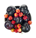 Cherries and plums in bowl Stock Photo