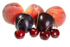 Cherries plums and peaches. Isolated cherries plums and peaches on white background royalty free stock photography