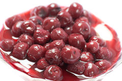 Cherries in the pudding. Cherries in pudding on white background Stock Photos