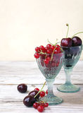 Cherries and red currants. In glass royalty free stock images