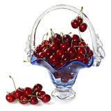 Cherries red in glass vase. On white background royalty free stock photography