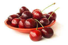 Cherries on a red plate Stock Photos