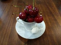 Cherries. Rich and juicy, seasonal, or in jam, with that bright red color are always a delicacy to the palate, either in a plate, a cup or collected from the stock images