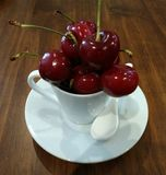Cherries. Rich and juicy, seasonal, or in jam, with that bright red color are always a delicacy to the palate, either in a plate, a cup or collected from the royalty free stock photography