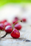 Cherries on a rough wooden surface Royalty Free Stock Images