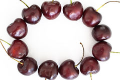 Cherries round frame. On white background Royalty Free Stock Image